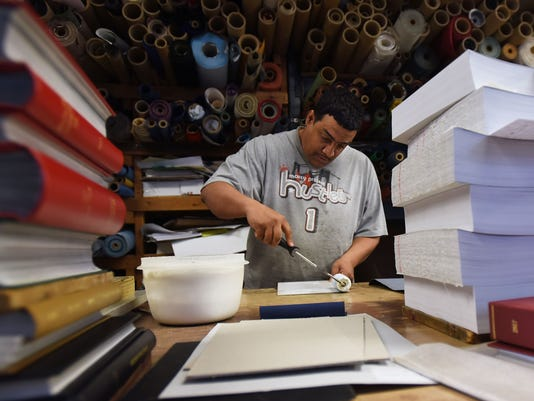 Book binding: an ancient craft kept alive by bookmaker in nj keep it going, no